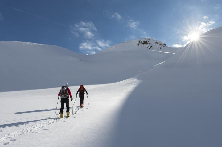 People ski touring in the mountains